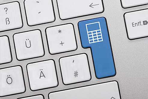 Close up of computer keys with calculator symbol on blue key - TSF000270