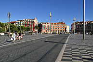 Europe, France, Provence, Alpes Maritimes, Cote d'Azur, Nice, View of people walking besides rail track at Place Massena - ES000034