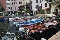 Europe, Italy, Lombardia, Limone sul Garda, View of moored motor boats at Lake Garda - ES000063