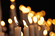 Germany, North Rhine-Westphalia, Kevelaer, Close up of burning devotional candles - KJF000099