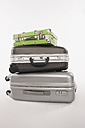 Stack of suitcases and luggages against white background - WESTF016725