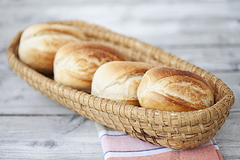 Germany, Close up of bread rolls in bread basket on napkin - MAEF003358