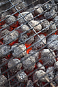 Germany, Burning coal briquettes of barbecue grill, close up - MAEF003416