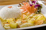 Germany, Bavaria, Munich, Close up of thai dish with boiled rice - RNF000589
