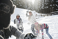 Austria, Salzburg Country, Flachau, Young people snow fighting in snow - HHF003655