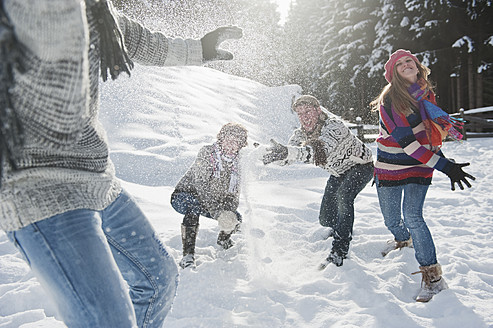 Austria, Salzburg Country, Flachau, Young people snow fighting in snow - HHF003656