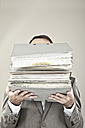 Close up of mature businessman at office holding stack of file - MAEF003433