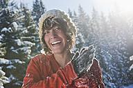 Austria, Salzburg Country, Flachau, Young woman having fun in snow - HHF003700
