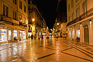 Europe, Portugal, Lisbon, Baixa, View of Rua Augusta road with pedestrian and shopping mile at night - FO003495