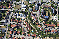 Europe, Germany, North Rhine-Westphalia, Cologne, Hochkirchen, Aerial view of solar systems on roofs of housing estate - CS015292
