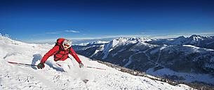 Austria, Salzburg Country, Altenmarkt-Zauchensee, Mid adult man skiing on ski slope in winter - HHF003738