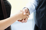 Germany, Bavaria, Diessen am Ammersee, Close up of young business people shaking hands - JRF000279
