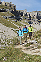 Austria, Kleinwalsertal, Group of people hiking on mountain trail - MIRF000223