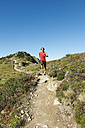 Austria, Kleinwalsertal, Mid adult man running on mountain trail - MIRF000259