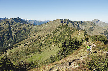 Austria, Kleinwalsertal, Mid adult man hiking on mountain trail - MIRF000265