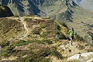 Austria, Kleinwalsertal, Mid adult man hiking on mountain trail - MIRF000268
