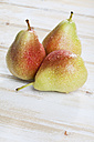 Close up of pears on wooden background - MAEF003521