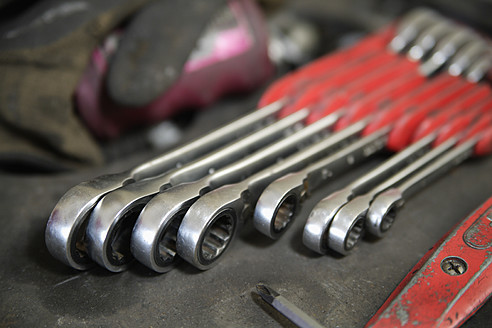 Germany, Ebenhausen, Close up of various spanners in repair garage - TCF001641