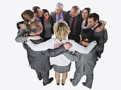 Business people forming huddle against white background - WESTF017010