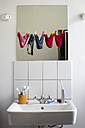 Germany, Hessen, Frankfurt, Empty bathroom with mirror reflection of underwears - MUF001066