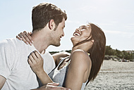 Spain, Majorca, Young couple kissing each other, smiling - WESTF017144