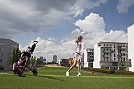 Germany, Bavaria, Munich, Young woman playing city-golf - MAEF003693