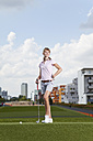 Germany, Bavaria, Munich, Young woman playing city-golf - MAEF003694