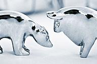Metal bull and bear figurine on white background - TSF000352