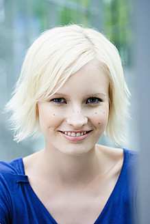 Germany, Bavaria, Munich, Young woman smiling, portrait - SPOF000017