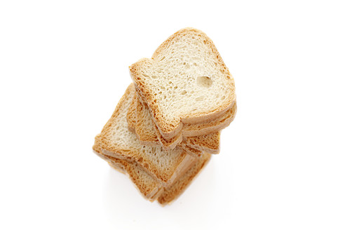 Stack of toast on white background, close up - HSTF000001