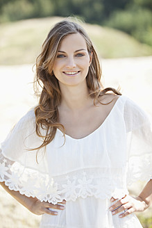 Germany, Bavaria, Young woman smiling, portrait - MAE003882