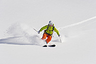 Austria, Young woman doing alpine skiing - MIRF000297
