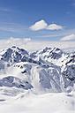 Austria, Stuben, Young couple doing telemark skiing on arlberg mountain - MIRF000303