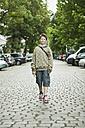 Germany, Berlin, Boy standing in street - WESTF017485