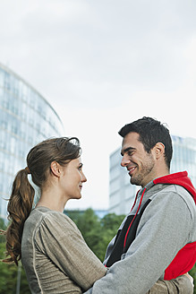 Germany, Berlin, Couple embracing in park - WESTF017596