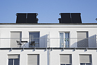 Germany, Cologne, Roof of residential building with solar panels - GWF001581
