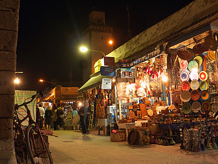 Morocco, Essaouira, People in souk at night - BSC000091