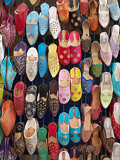 Morocco, Essaouira, Leather slippers in shop at souk - BSCF000095