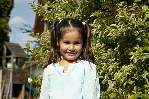 Germany, Bavaria, Huglfing, Girl in garden, smiling, portrait - RIMF000001