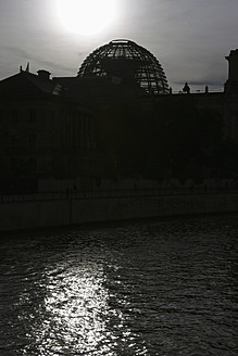 Germany, Berlin, Reichstag, Silhouette of building with Spree River - JMF000088