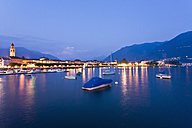 Switzerland, Ticino, View of Ascona at dusk with boats in Lake Maggiore - WDF001049