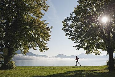 Germany, Bavaria, Walchensee, Mature man jogging - MIRF000352