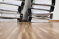 Piled of office files on parquet floor - GWF001599