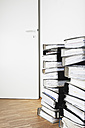 Piled of office files on parquet floor - GWF001602