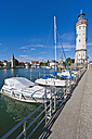 Germany, Bavaria, Lindau,  View of light house with city - WDF001064