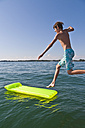 Germany, Baden-Wurttemberg, Teenage boy jumping in Lake Constance - WDF001096
