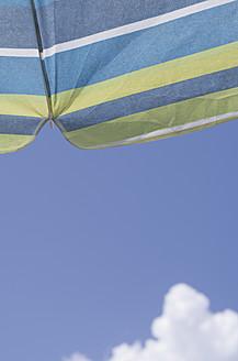 Greece, Ionian Islands, Ithaca, Beach umbrella against sky, close up - MUF001158