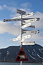 Europe, Norway, Spitsbergen, Svalbard, Longyearbyen, Directional sign with caution polar bear sign - FOF003700