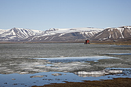 Europe, Norway, Spitsbergen, Svalbard, Longyearbyen, View of lake reservoir with snowcapped mountains - FOF003706
