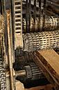 Germany, Upper Bavaria, Schaeftlarn, Wood in machine at factory - TCF002129